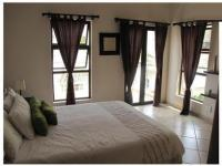 Bed Room 1 - 22 square meters of property in Zwartkops Golf Estate