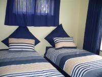 Bed Room 1 of property in Umtentweni