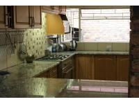 Kitchen - 23 square meters of property in Faerie Glen