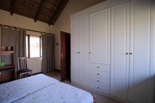 Bed Room 1 - 16 square meters of property in Woodhill Golf Estate