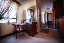 Main Bedroom - 26 square meters of property in Woodhill Golf Estate
