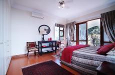 Bed Room 1 - 29 square meters of property in Woodhill Golf Estate