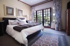Main Bedroom - 20 square meters of property in Woodhill Golf Estate