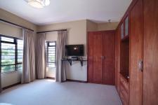Bed Room 1 - 21 square meters of property in Woodhill Golf Estate