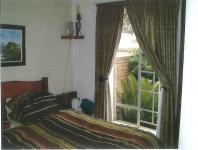 Main Bedroom - 12 square meters of property in Die Hoewes