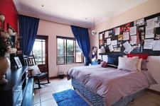 Bed Room 1 - 12 square meters of property in Woodhill Golf Estate