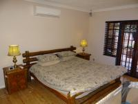 Main Bedroom - 26 square meters of property in Rooihuiskraal North