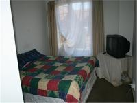 Bed Room 1 - 13 square meters of property in Rooihuiskraal North