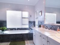 Main Bathroom of property in Woodhill Golf Estate