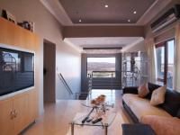 Lounges - 71 square meters of property in Woodhill Golf Estate