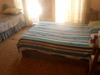 Bed Room 1 of property in Pretoria Rural
