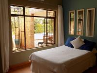 Bed Room 1 - 10 square meters of property in Safari Tuine