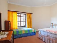 Bed Room 1 - 20 square meters of property in Woodhill Golf Estate