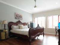 Main Bedroom of property in Woodhill Golf Estate