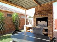 Patio of property in Rooihuiskraal North